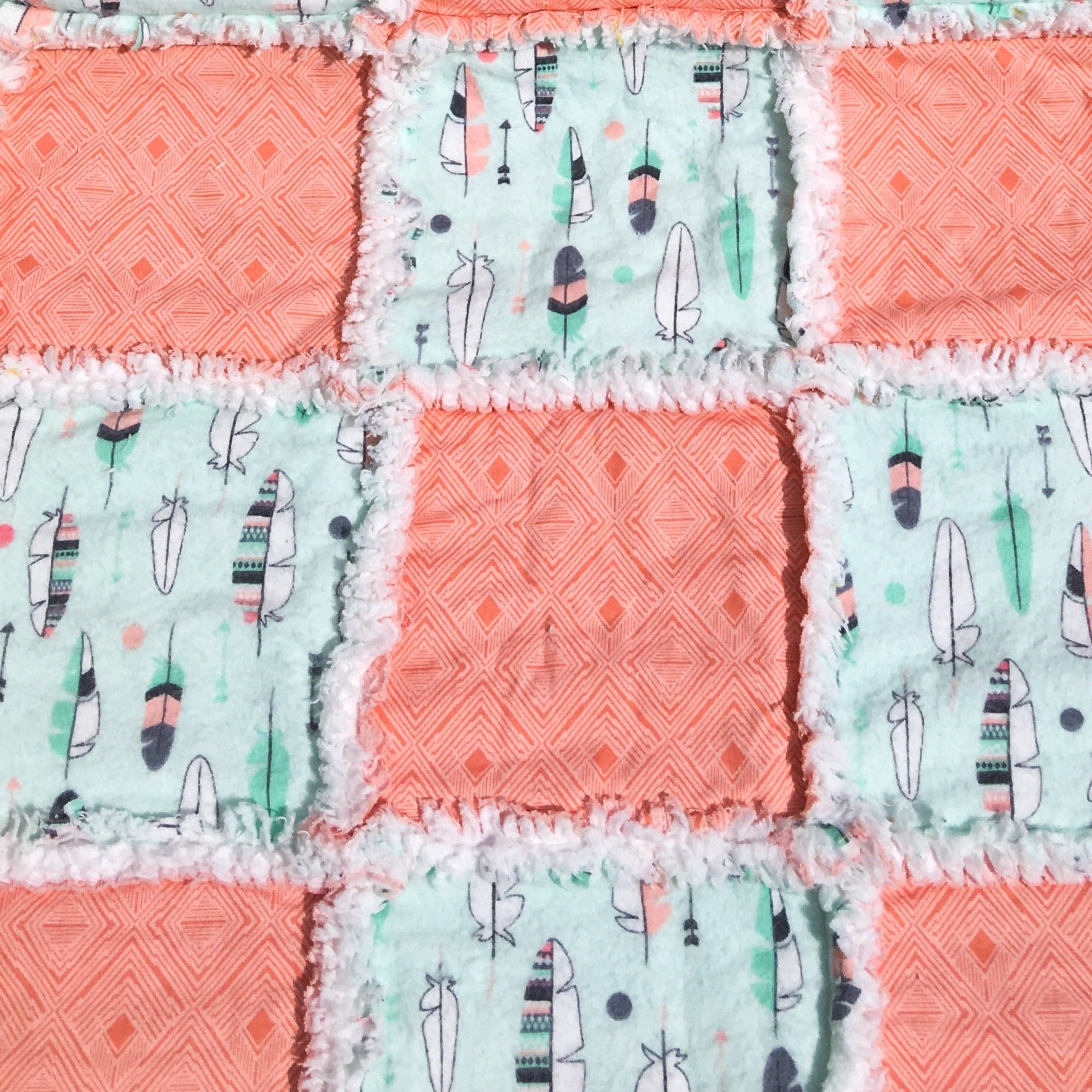 All natural cotton rag quilt in peach and mint, with feathers and patterned peach squares
