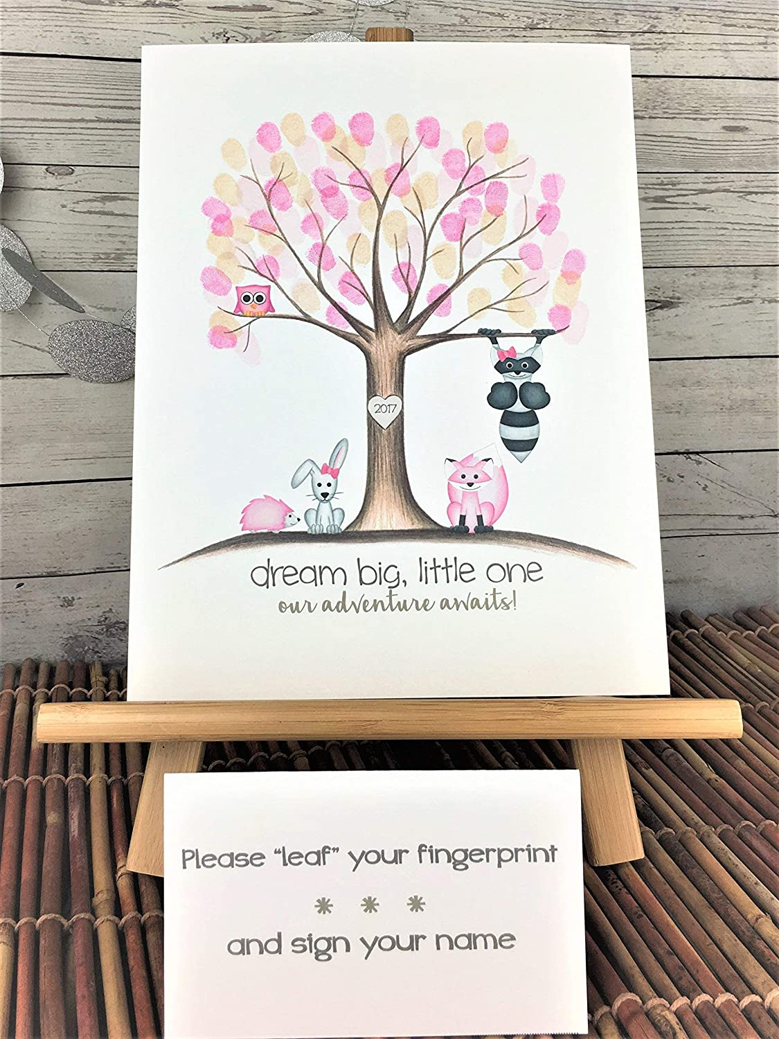 Customizable woodland animal fingerprint tree for a girl's woodland animal themed baby shower, featuring a pink owl, fox, and hedgehog, and a raccoon and bunny with pink bows.