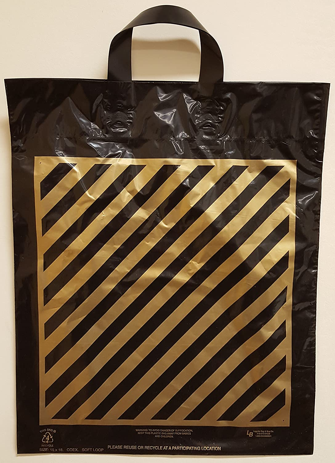 """WOW..1 penny Shipping!!!""- 100 Large size Bags, Size:15x18, Black with Gold Stripes Flexi-Loop Handle Plastic Shopping Bags, $31.99 per 100, 31.9 cents per bag."