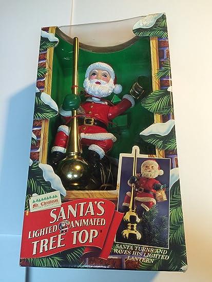 Mr. Christmas Lighted Animated Santa's Tree Topper - Amazon.com: Mr. Christmas Lighted Animated Santa's Tree Topper: Home