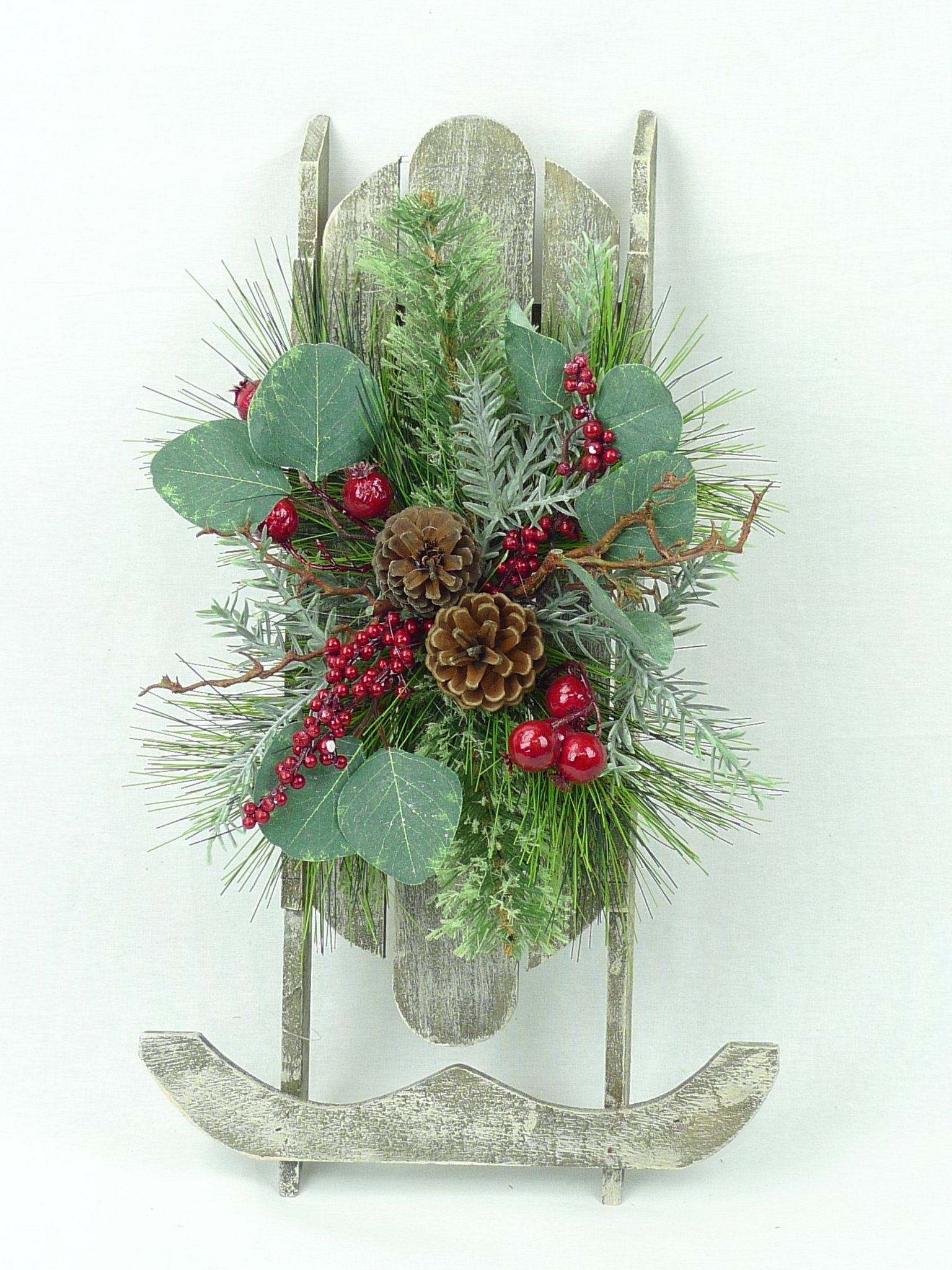 Brighton Pine White Washed Wooden Christmas Sled with Pine, Pinecones, and Red Berry Decoration