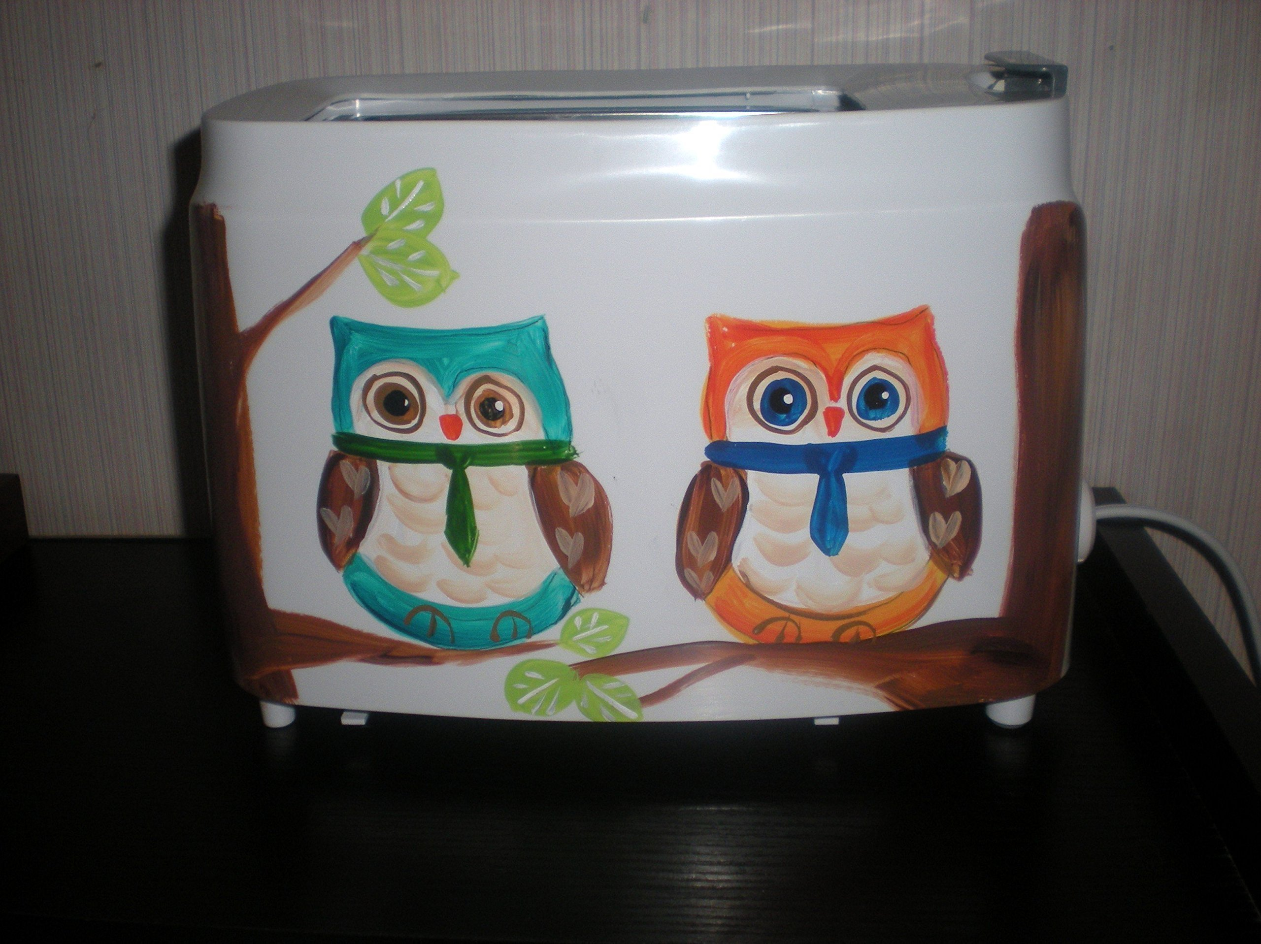 Hand painted toaster. In fun owls perched on their trees. 2 boys and 2 girls.