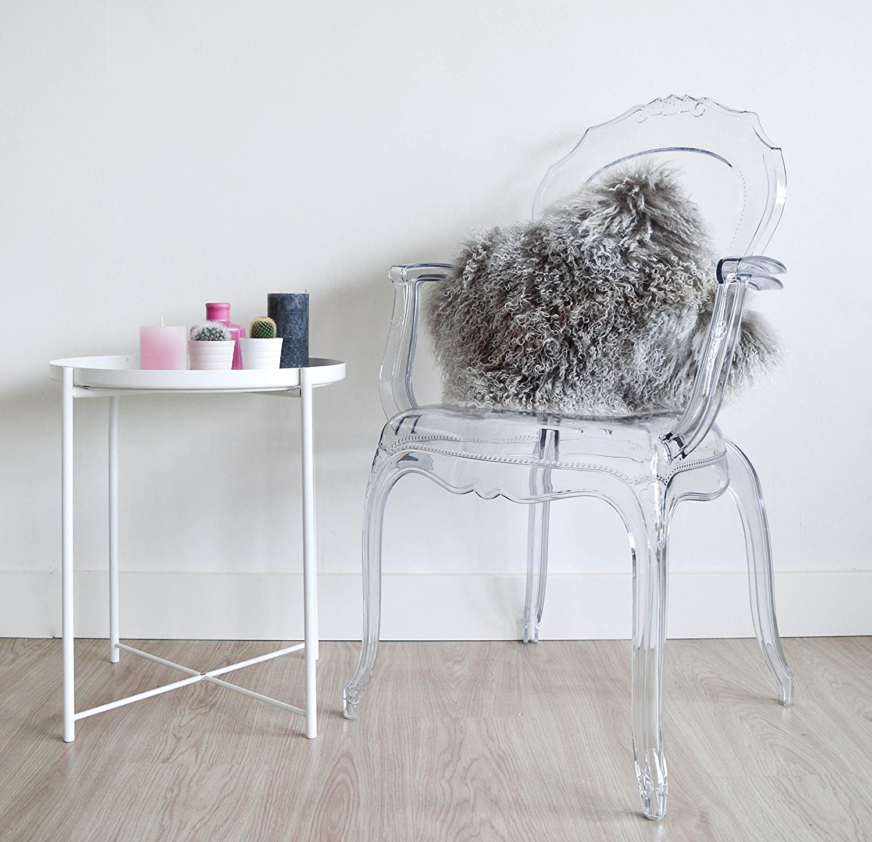 Fenomenal silla Broxster de diseño único y plástico cristalino. Aspecto muy moderno.