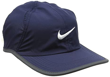 Amazon.com   NIKE FEATHER LIGHT HAT (version 2.0) ADULT UNISEX -NAVY ... 15a4f59d17f