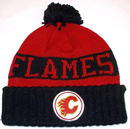 c1a3c69b542 Amazon.com   Calgary Flames Cuff Pom Vintage Hockey Mitchell   Ness Knit Hat  - Osfa   Cold Weather Hats   Sports   Outdoors