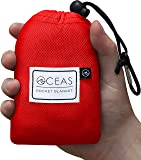 Oceas Outdoor Pocket Blanket - Compact Waterproof Mat Perfect for Camping Hiking Festival and Beach Use - Includes Sand Pockets and Built In Ground Stakes - Comes in a Compact Bag for Easy Travel
