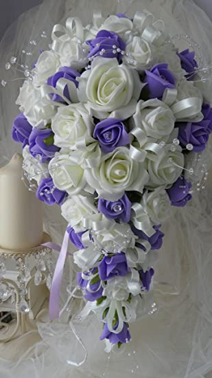 WEDDING FLOWERS BRIDES TEARDROP BOUQUET IN LILAC AND IVORY ROSES