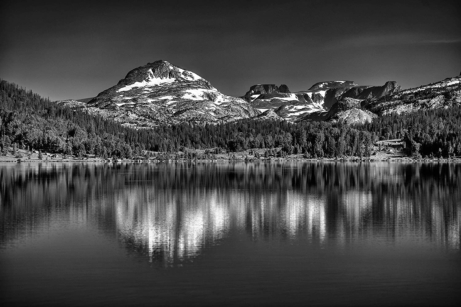 This fine art black and white landscape photo is of island lake beartooth mountains wyoming is available in print sizes up to 44x66 inches is perfect for