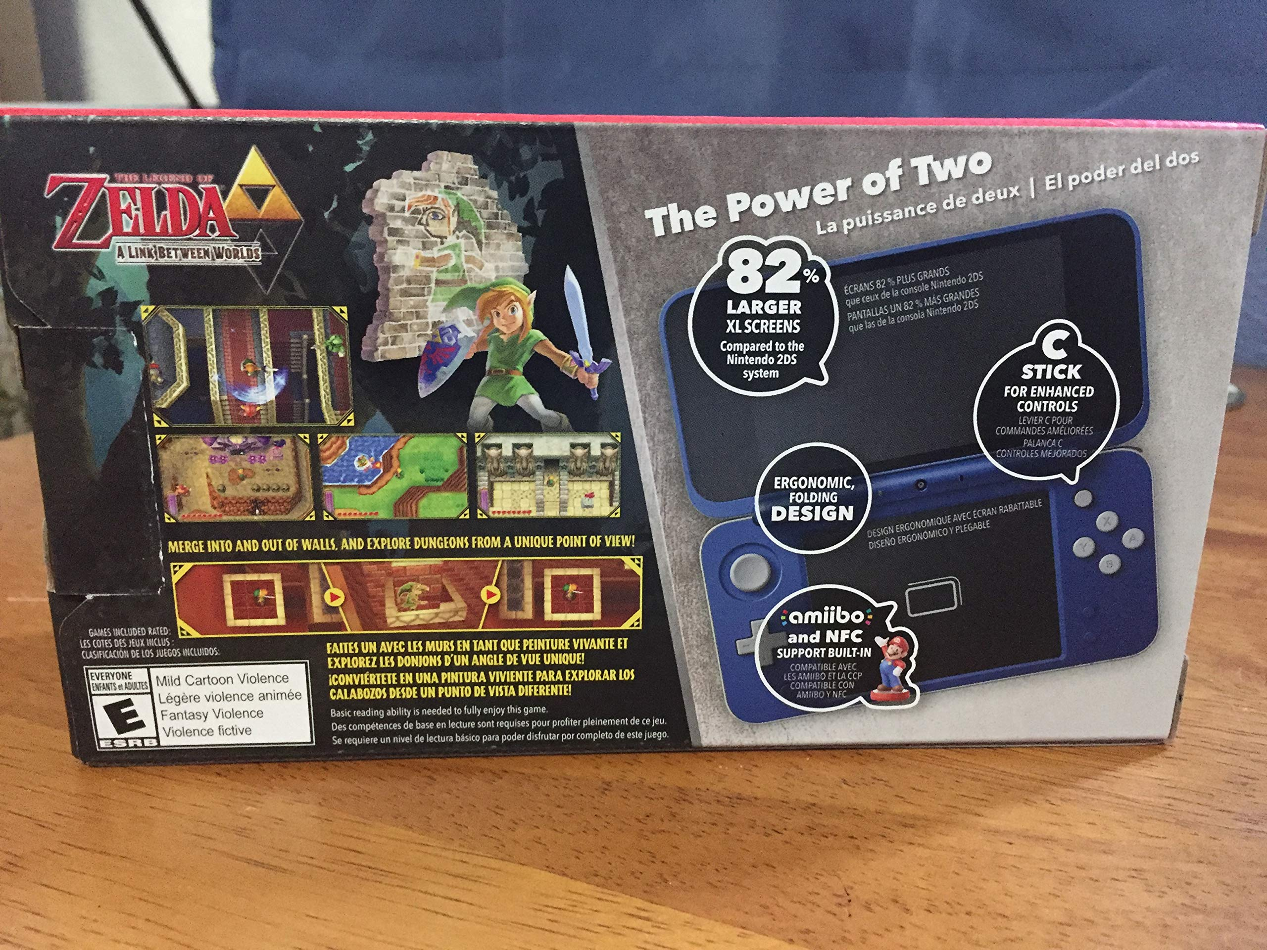 New Nintendo 2DS XL Hylian Shield Ed., w/ Legend of Zelda: A Link Between Worlds by Nintendο (Image #1)