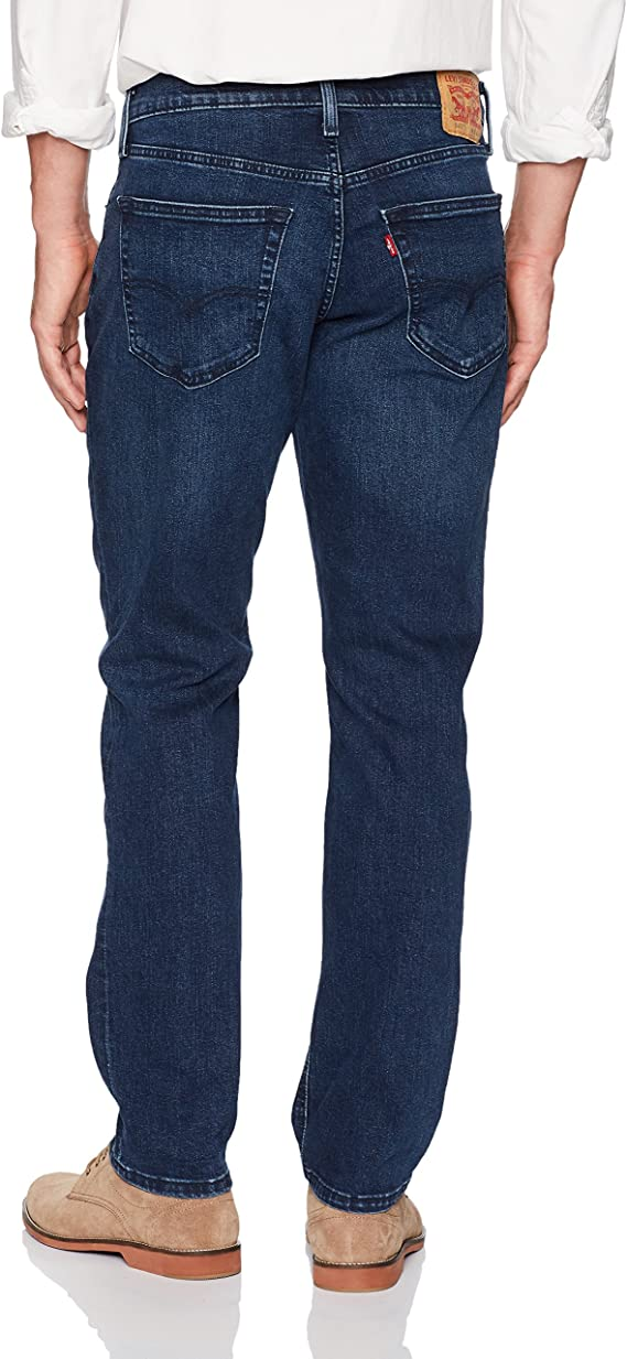 Model has worn dark blue jeans with brown shoes