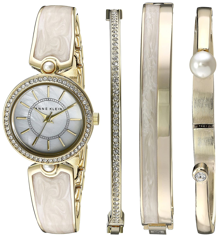 Ann klein Damen AK-248ivst Swarovski Kristall akzentuierten goldfarbenen Elfenbeinfarben Armbanduhr und Armreif