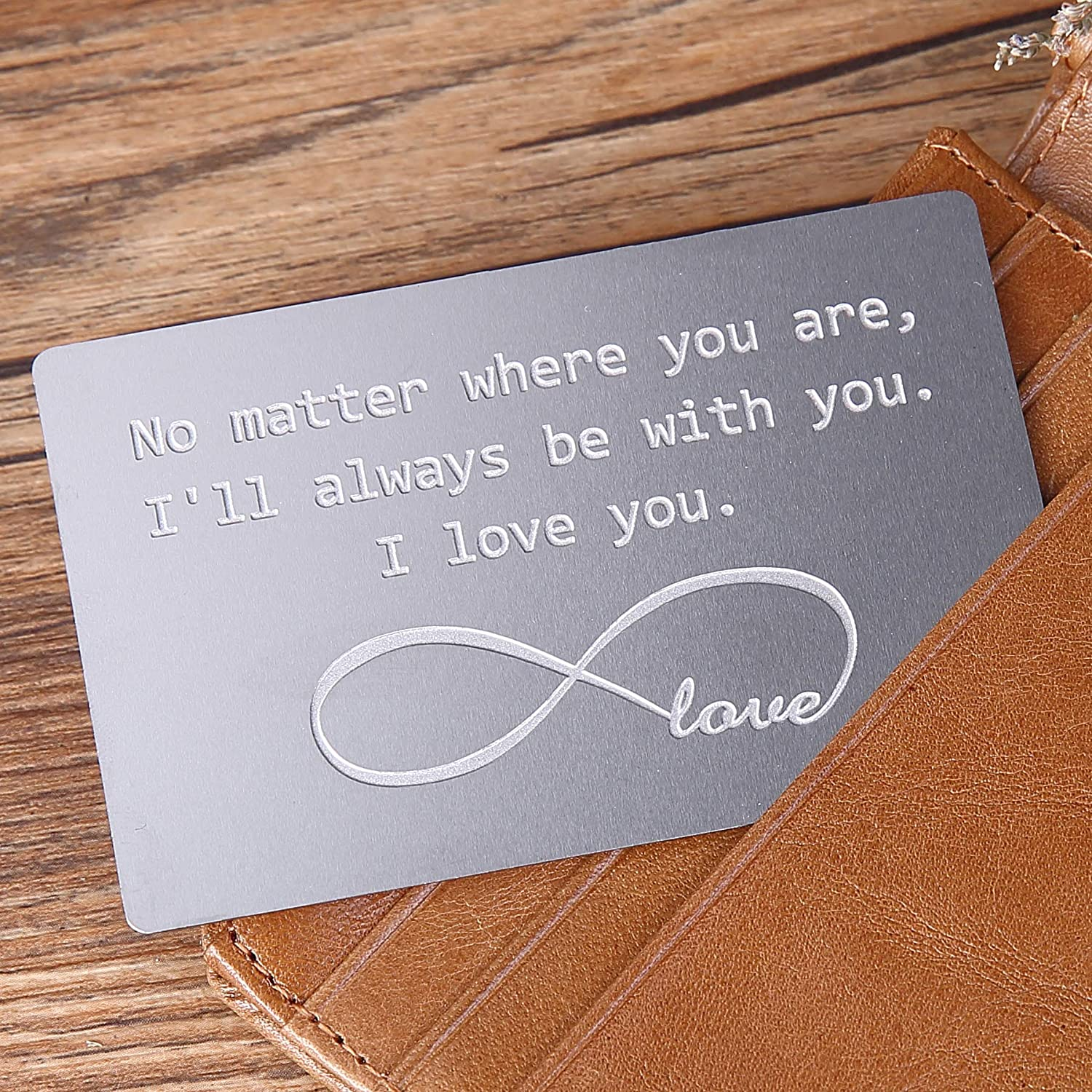 Image of an engraved metal wallet insert in gray color, for couple.