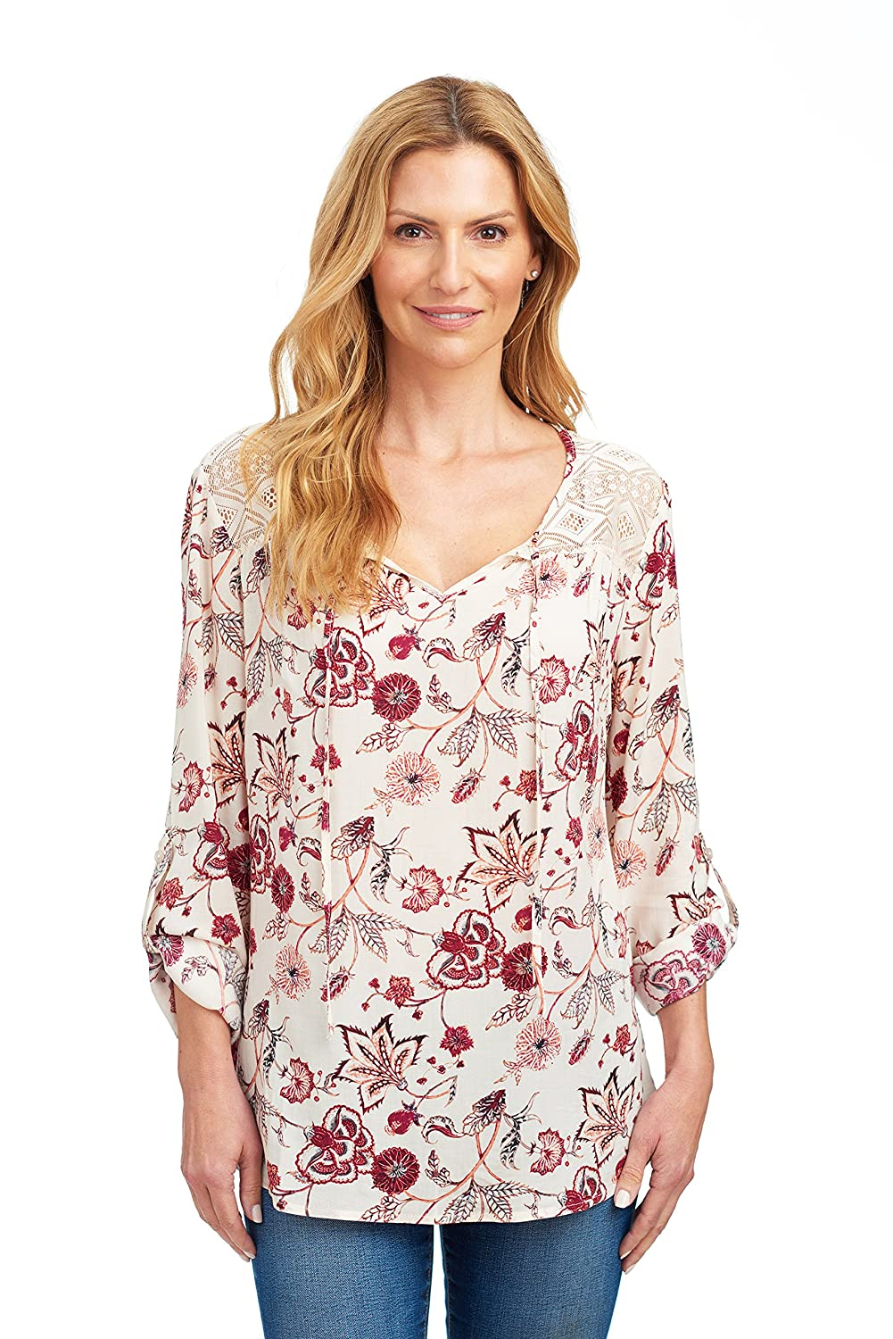 0c62b7a476dba Women's long sleeve blouses with a complementary flowy fit made from 100%  rayon. Roll tab cuffed sleeves. Keyhole-like tie neckline