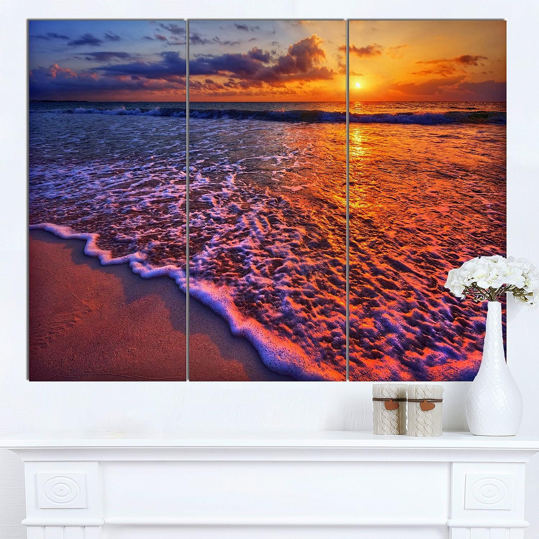CDM product Designart PT14431-3P Colorful Sunset & Wavy Waters Seashore Art Print on Canvas, 36x28 big image