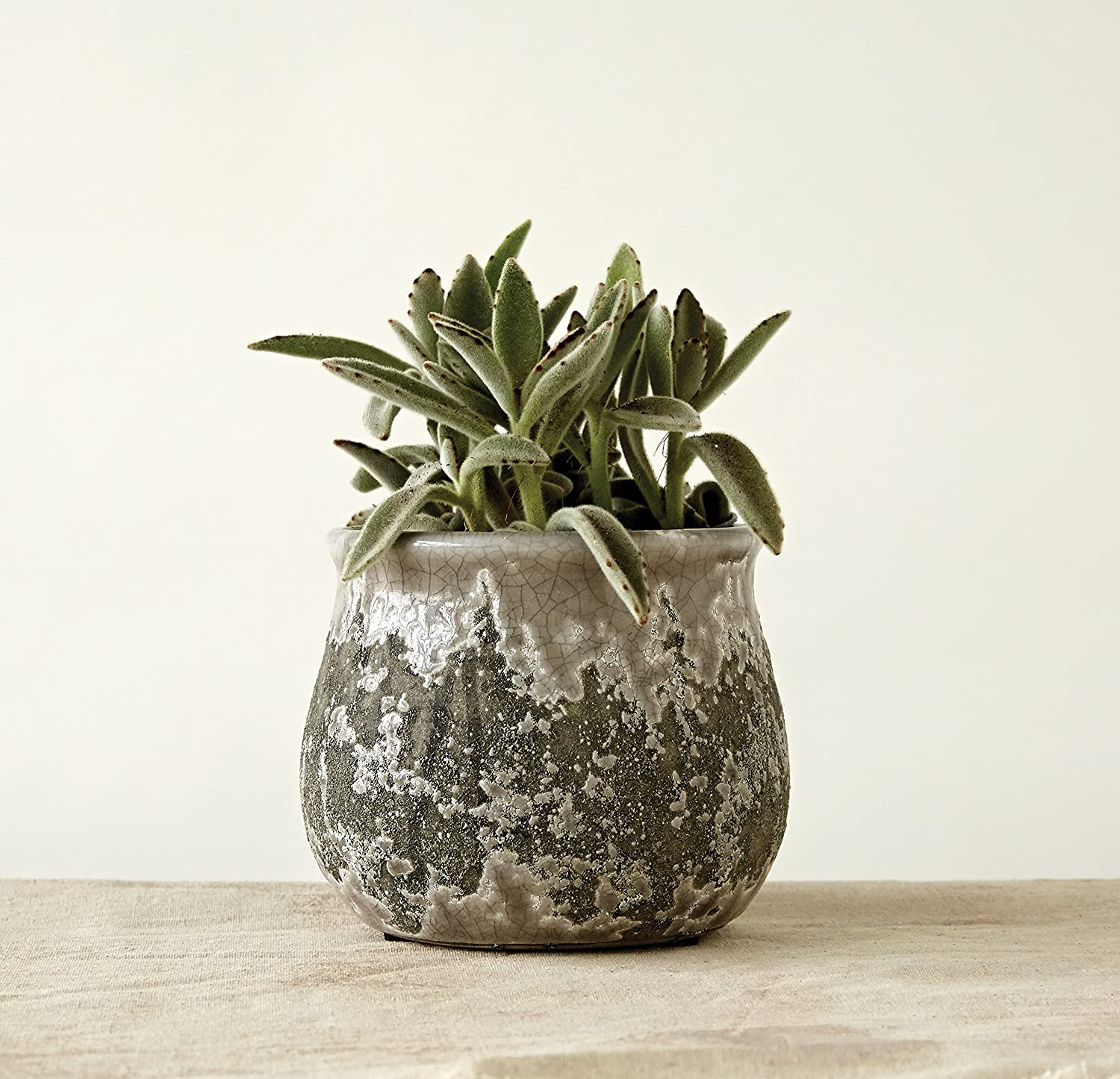 Distressed round grey terracotta planter for rustic country French farmhouse decorating and interior design.