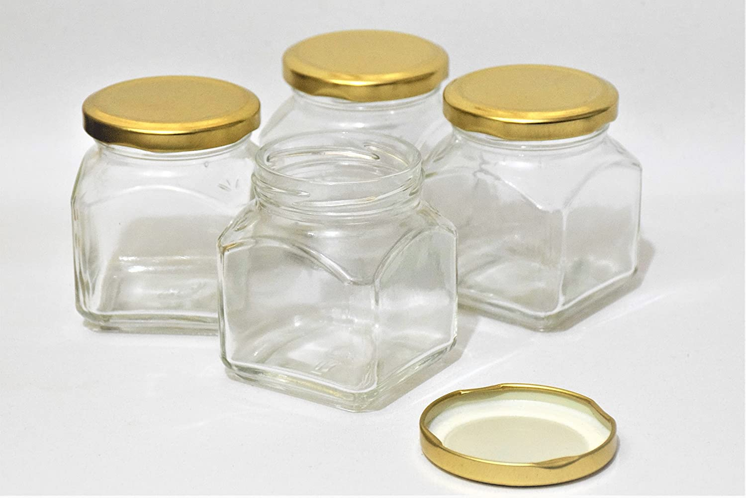 Pure Source India Small Glass jar Set of 4 pcs coming with metal Golden color Air Tight and Rust proof cap , Capacity 100 Gram About Made In India .