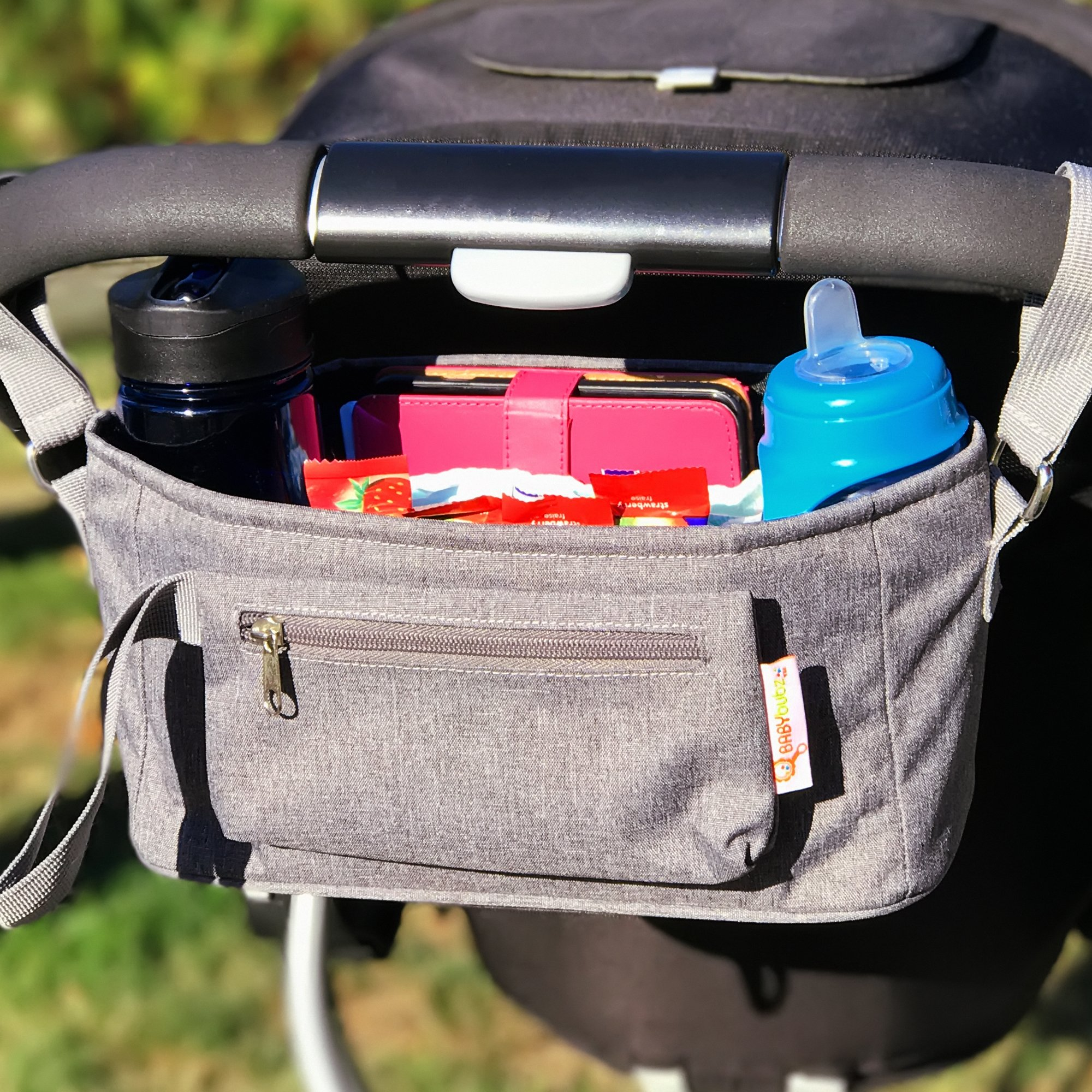 Baby Stroller Organizer by BabyBubz - Premium New Sleek Design - Durable Cup Holders - Universal Fit - tons of Storage for Phones, Keys, Diapers, Baby Toys, Snacks, Accessories - Best Shower Gift by BabyBubz (Image #8)