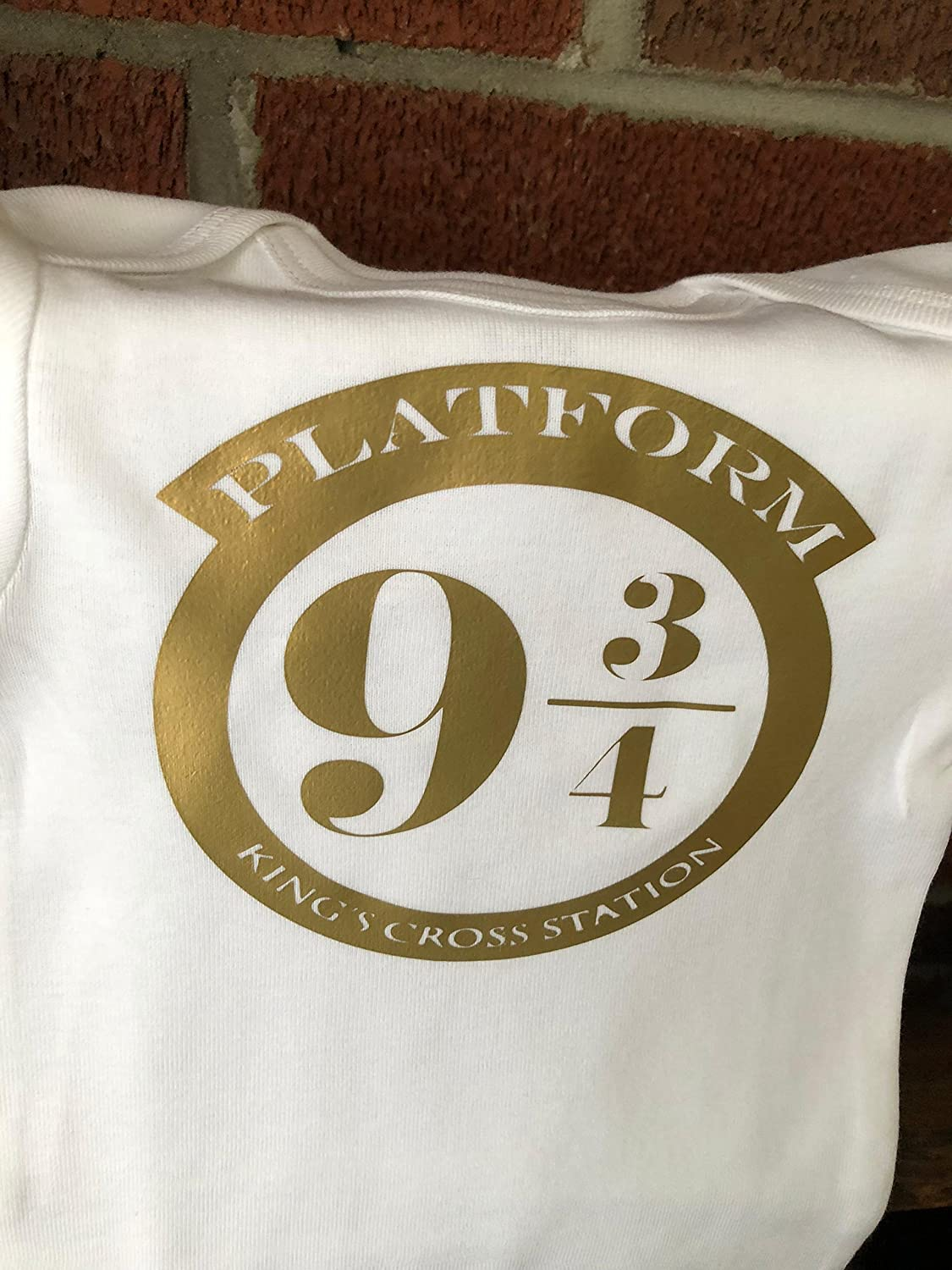 Platform 9 3/4 Harry Potter Inspired Vinyl Gold Onesie