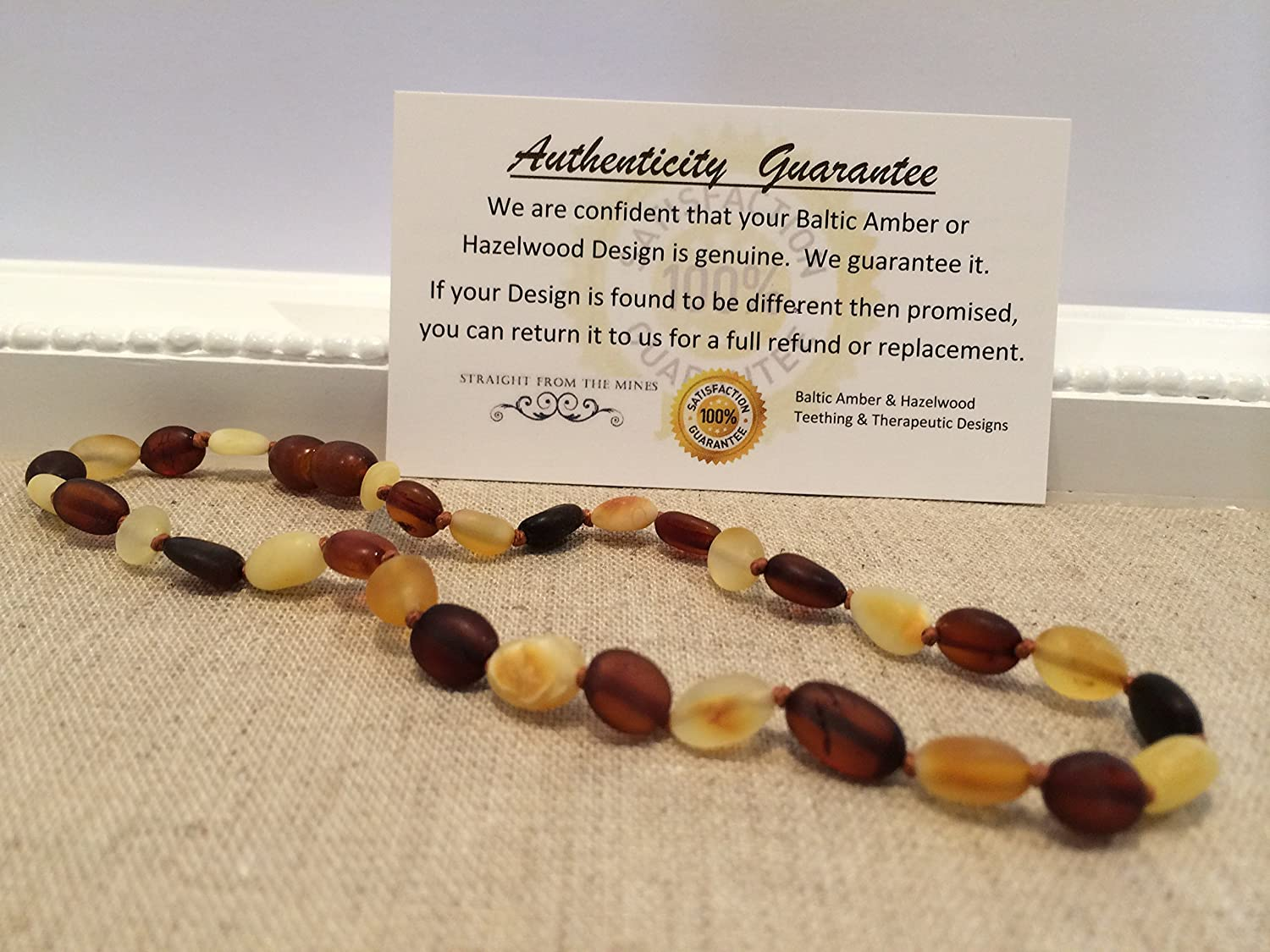 Baltic Amber Teething Necklace for Babies (Unisex) - Anti Flammatory, Drooling & Teething Pain Reduce Properties - Certificated Natural Oval Baltic Jewelry with the Highest Quality Guaranteed. Easy to Fastens with a Twist-in Screw Clasp Mothers Approved Remedies! Multi Milk Cognac Cherry Lemon Brown Black Yellow White Honey Raw Maximum Effective by Baltic Essentials   B00TO1NM3S