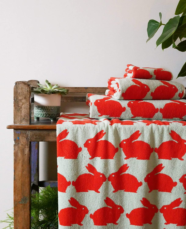 Red Anorak Kissing Rabbits Bath Mat