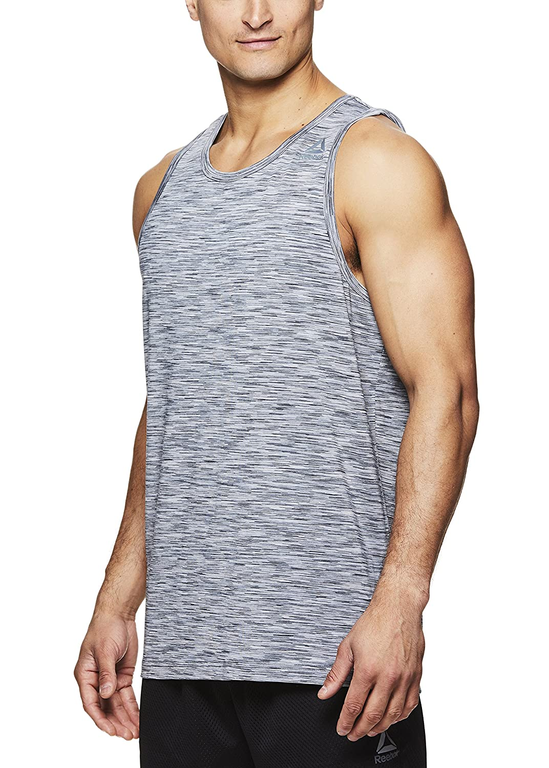 e6ad19e6673 PEAK PERFORMANCE: Reebok tanks set the new bar for men\'s gym shirts. Our  performance tank tops are perfect for any and all sports providing the  comfort and ...