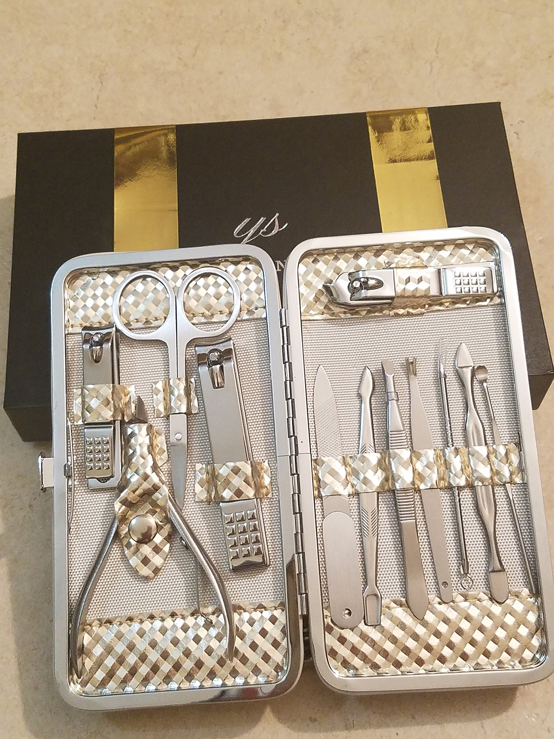 Amazing Professional Manicure Travel Set for men and women. 12 pieces kit of Stainless steel manicure & Pedicure clipping and trimming tools in an attractive Beautiful gold metallic case.