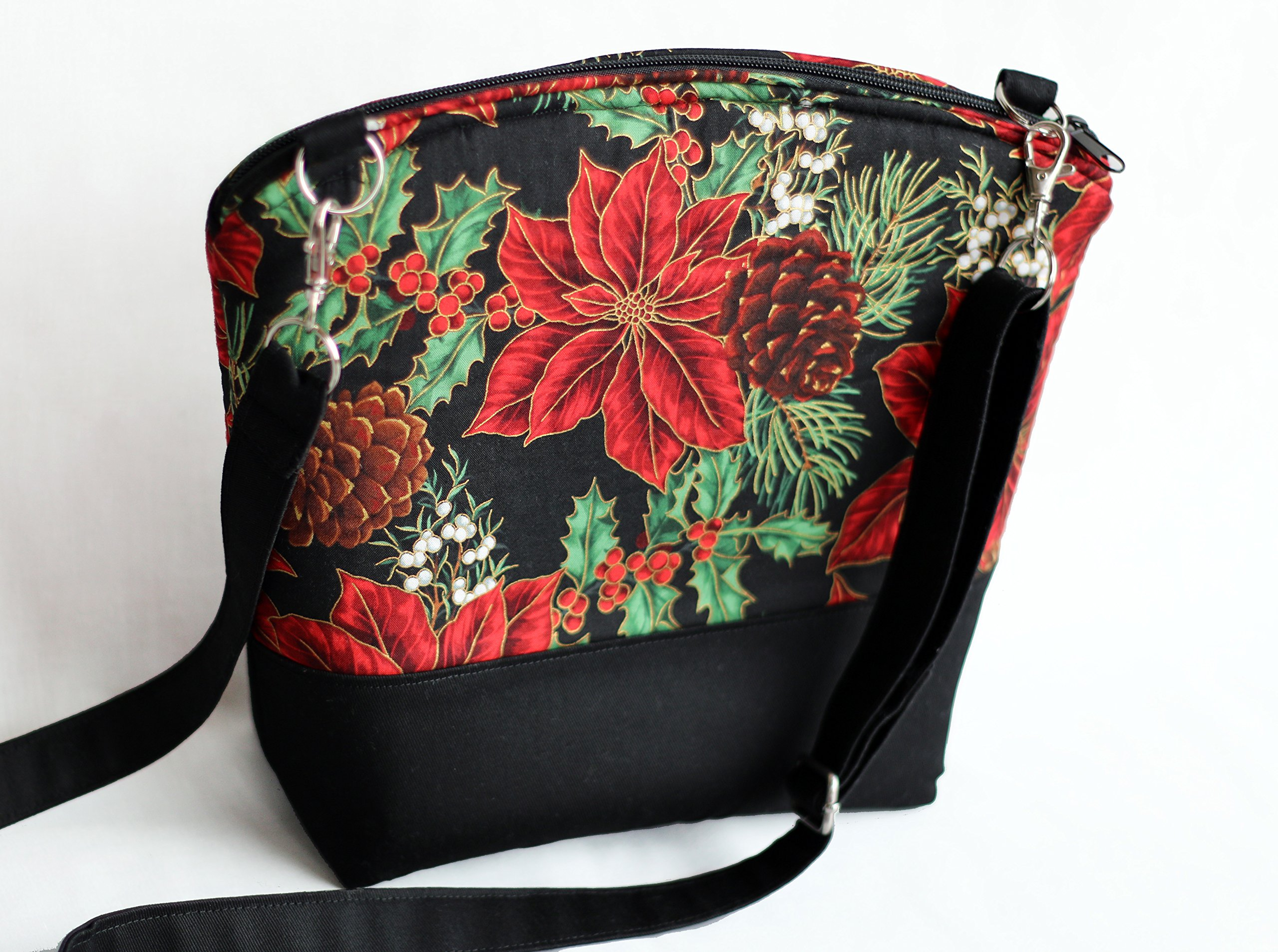 Lightweight Christmas arm / cross body purse. Poinsettia pattern. Fully padded with foam and lined with black cotton fabric. With zipper and interior pockets. Washable and iron safe. by Spool of Charm