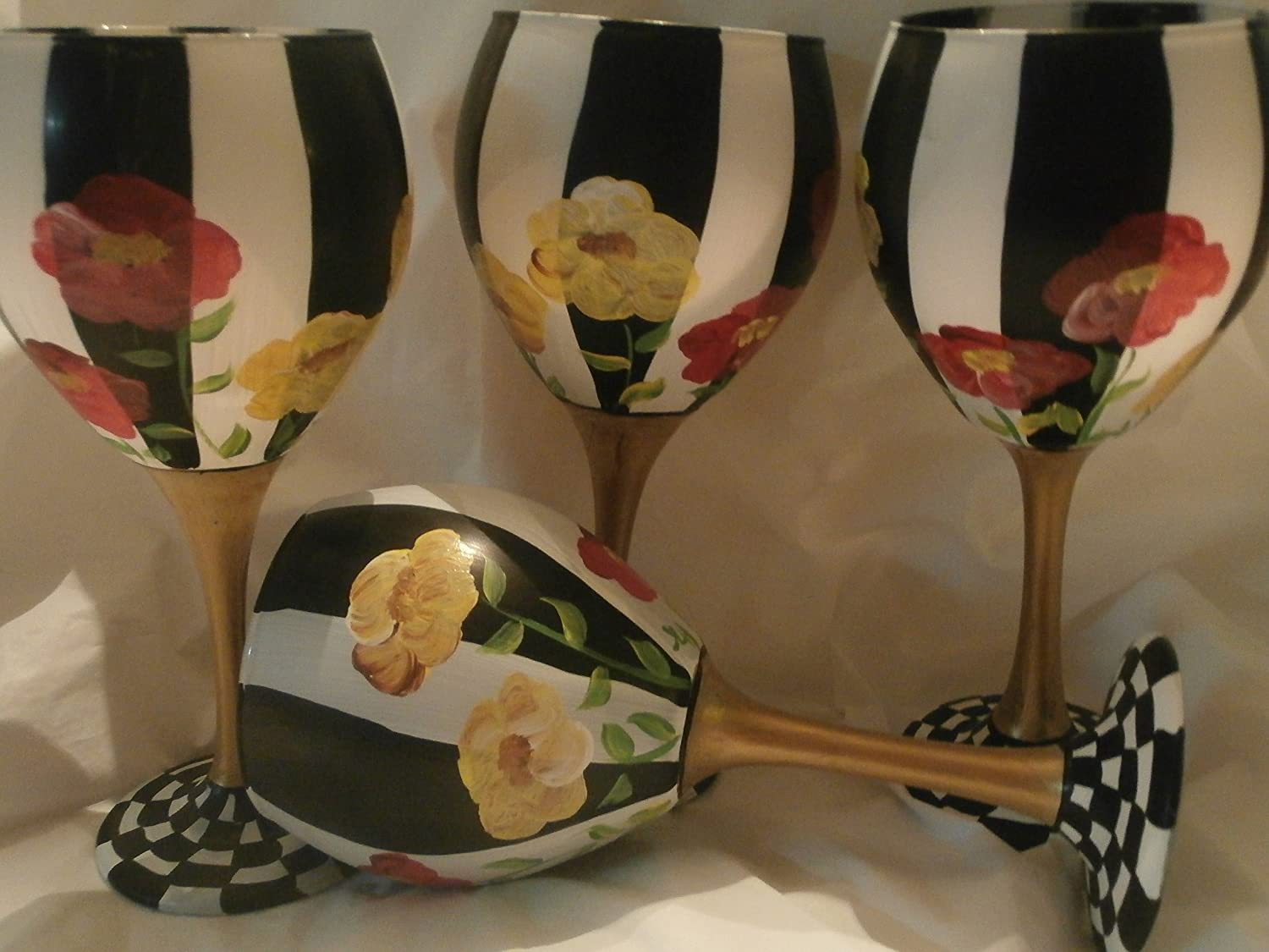 20 ounces each. usa Great set Painted with black and white stripes Set of 4 goblets. This set is so pretty Great gift Hand painted Red and Yellow poppies Gold Stem and checked base