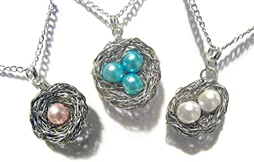 Sterling Silver Bird Nest Pendant Necklace With PInk and Blue Eggs