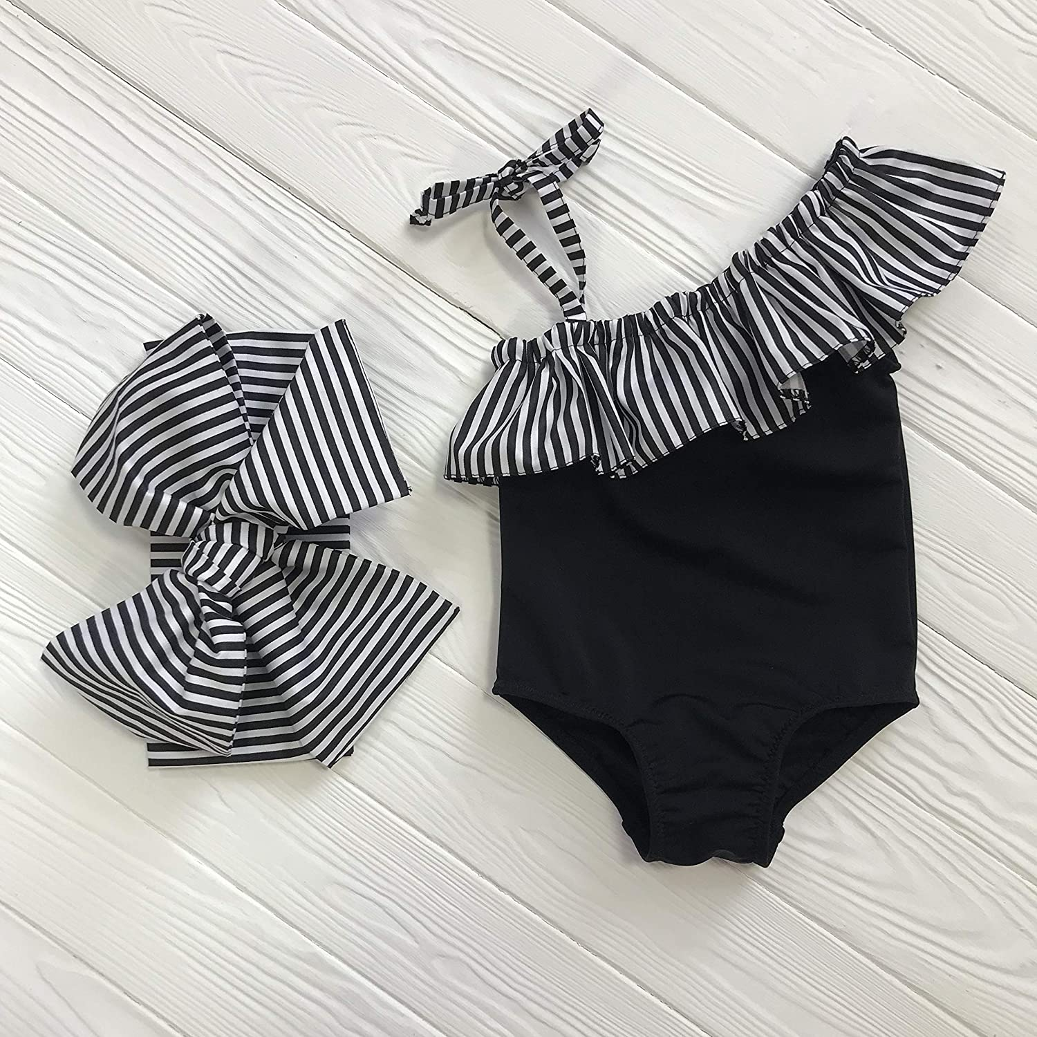 Black&White one shoulder girls swimsuit with striped ruffles and head bow by BabyLadySwim