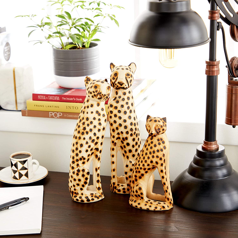 Deco 79 Hand-Carved Black & White Jacaranda Wood Cheetah Sculptures - Set of 3
