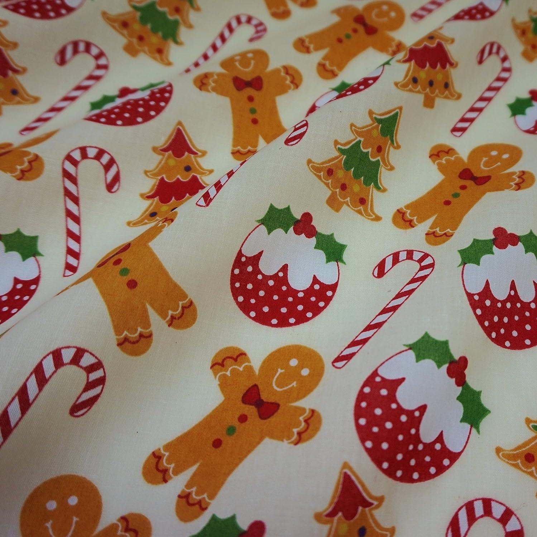 Nortex Mill Tessuto panna in policotone con omino & Christmas pudding (al metro)