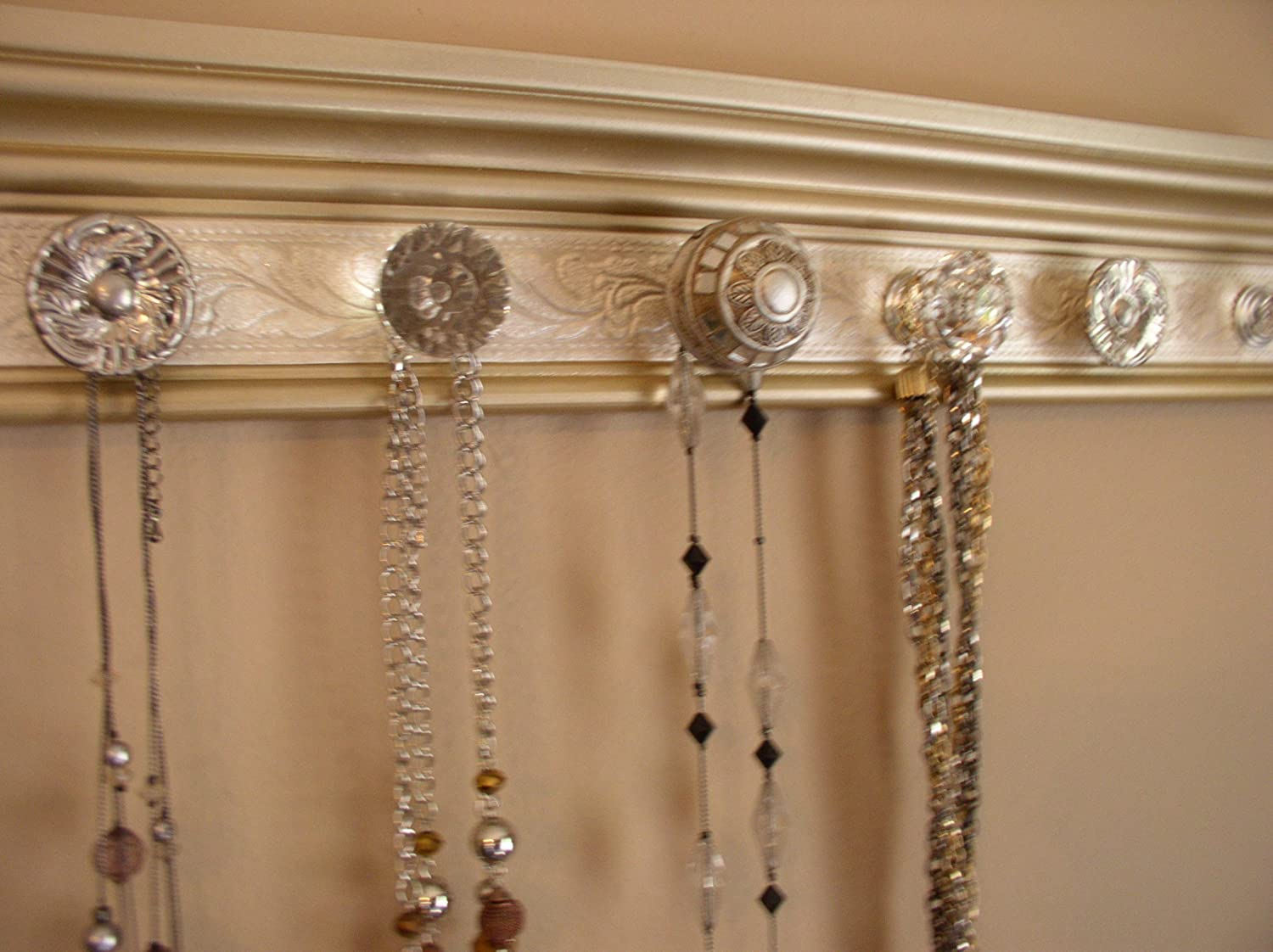 Available in 3 sizes with 5, 7 or 9 Knobs. Champagne Gold Jewelry Organizer.