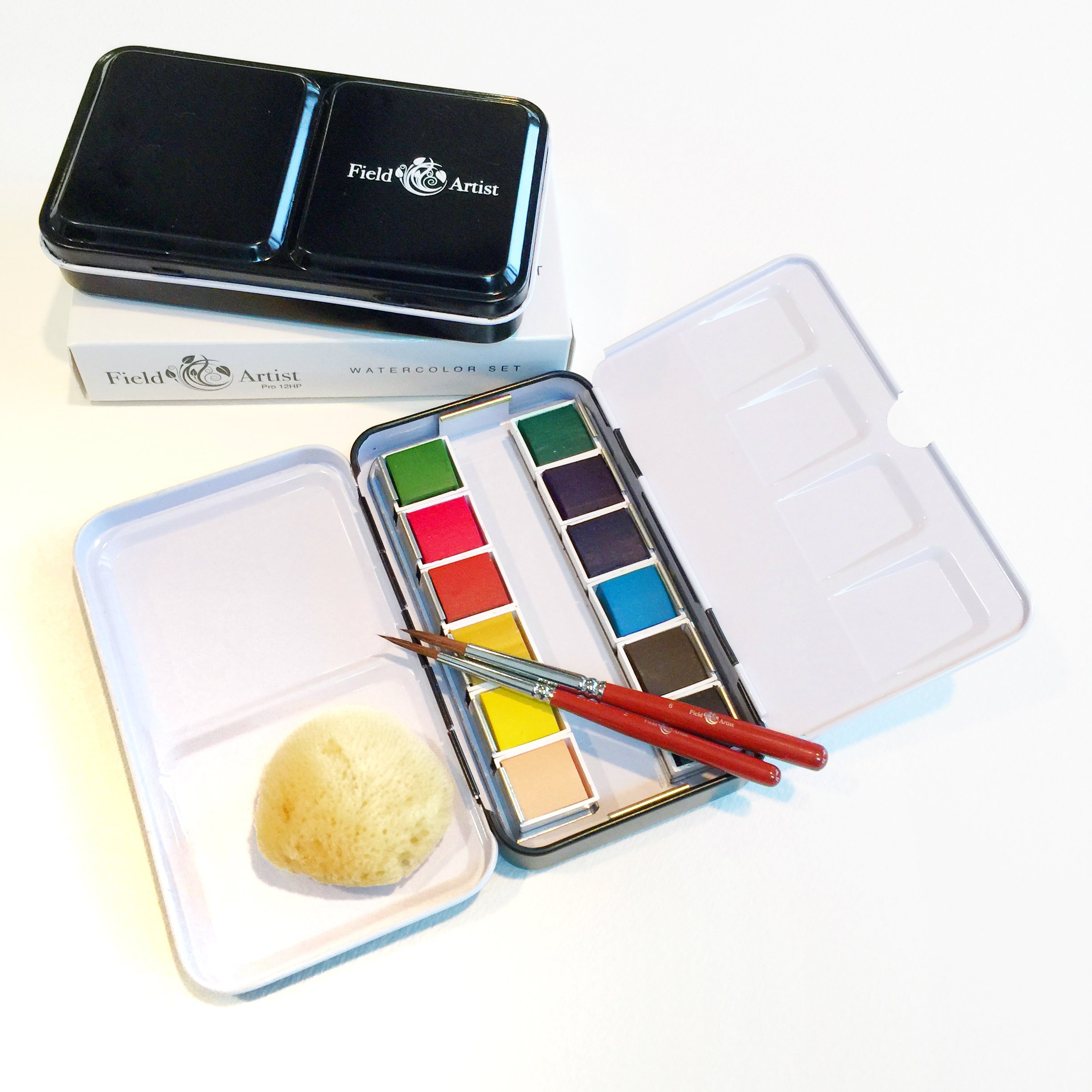 Field Artist Pro 12HP - Complete TRAVEL WATERCOLOR SET includes 12 Brilliant Half Pan Colors, 2 Custom Brushes, a Genuine Sea Sponge, a Classic Metal Field Box, all fits in your Pocket!
