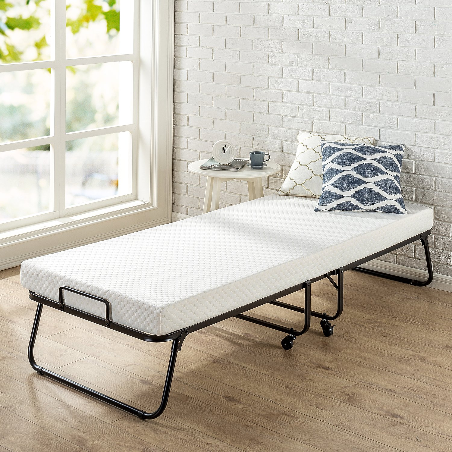 1. Zinus Roll Away Folding Guest Bed Frame with 4 Inch Comfort Foam Mattress, Narrow Twin / 30