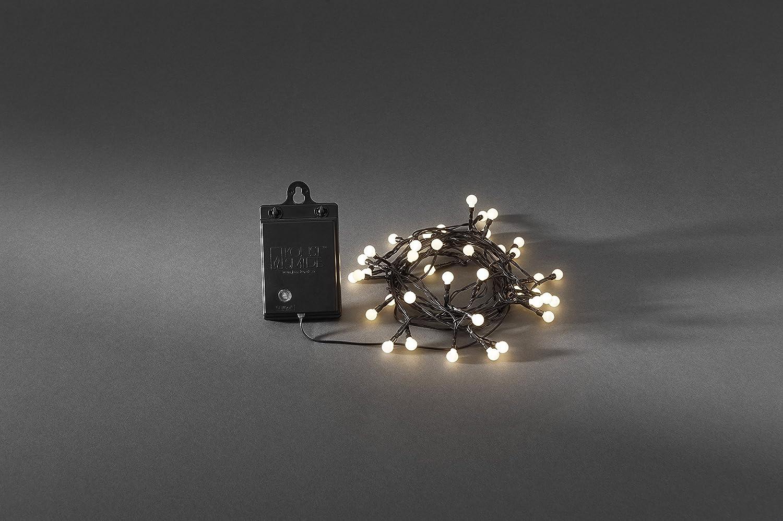 Konstsmide 3741-100 LED Globelichterkette mit runden Dioden // f/ür Au/ßen 6h und 9h Timer und Schalter // 80 warm wei/ßen Dioden // schwarzes Kabel // mit Lichtsensor exkl. IP44 //  Batteriebetrieben: 4xAA 1.5V