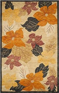 Amazon Com Safavieh Tibetan Collection Tb518a Hand Knotted Floral Premium Wool Area Rug 6 X 9 Black Rust Furniture Decor