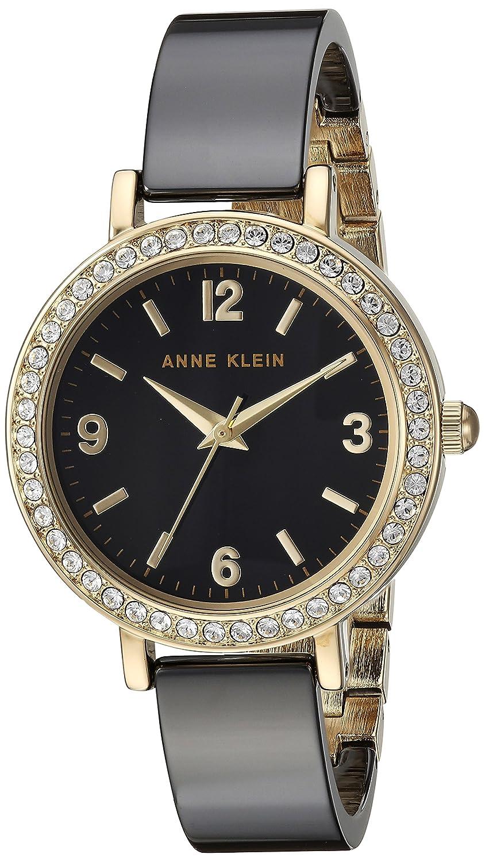 6b0bd57e4 Amazon.com: Anne Klein Women's Swarovski Crystal Accented Gold-Tone and  Black Ceramic Bangle Watch: Watches