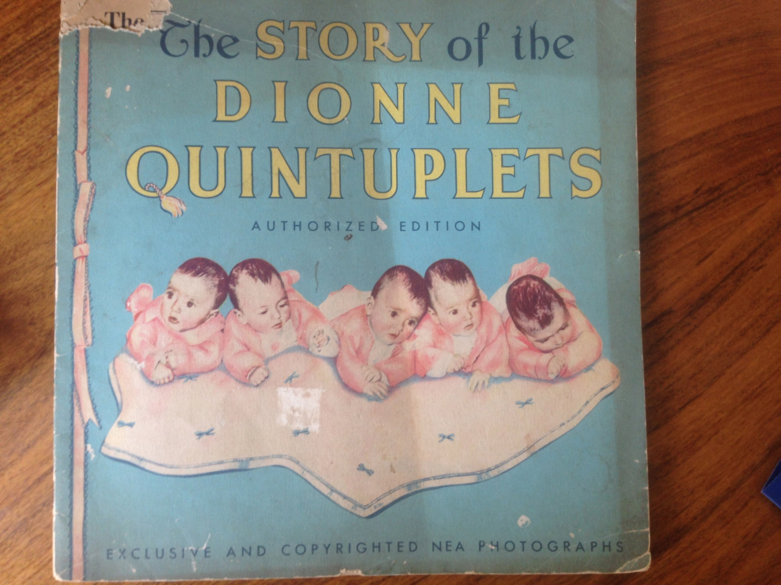 The Pictorial Story of the Dionne Quintuplets Authorized Edition (The Five Little Dionnes and How They Grew: Exclusive and Copyrighted NEA Photographs)