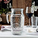 Bormioli 'Romantica' glass carafe with ice compartment, carafe filling capacity of 1.8 litres, keeps drinks cool without becoming watered down, glass embossing in a beautiful vintage design
