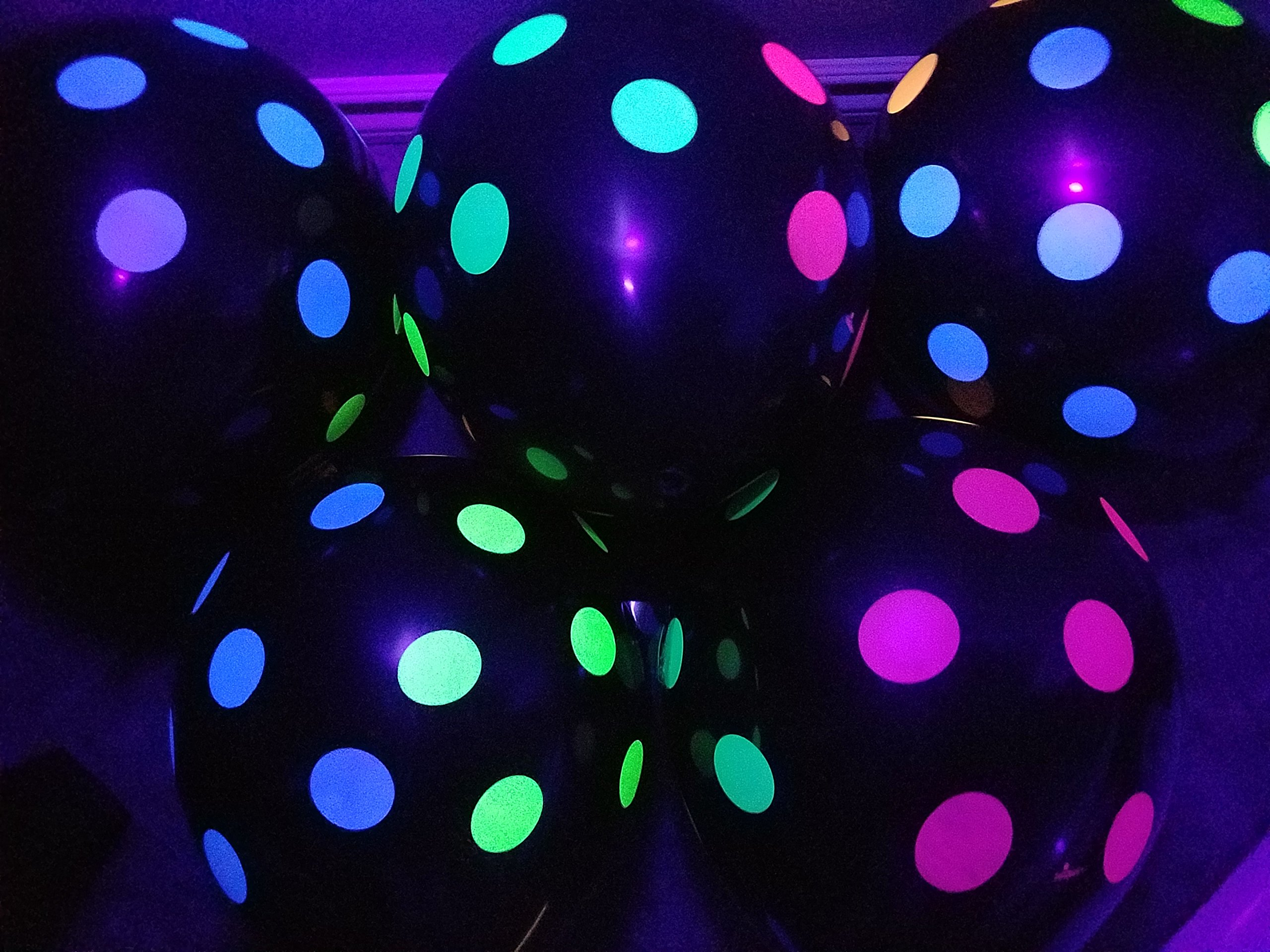 Blacklight Party Balloons - Black with Neon Polka Dots that Glow in the Dark under Blacklight - 25 Pack of 11 inch Latex Balloons