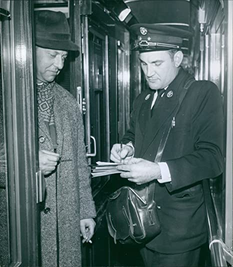 Amazon com: Vintage photo of A ticket checker checking ticket and