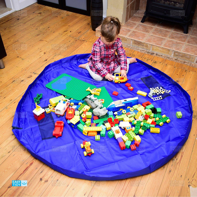 Alfombra de juego y almacenaje fácil de recoger. Se convierte rápidamente en una bandolera (mochila). Ideal para Legó, Duplo y otros juegos de niños para ...
