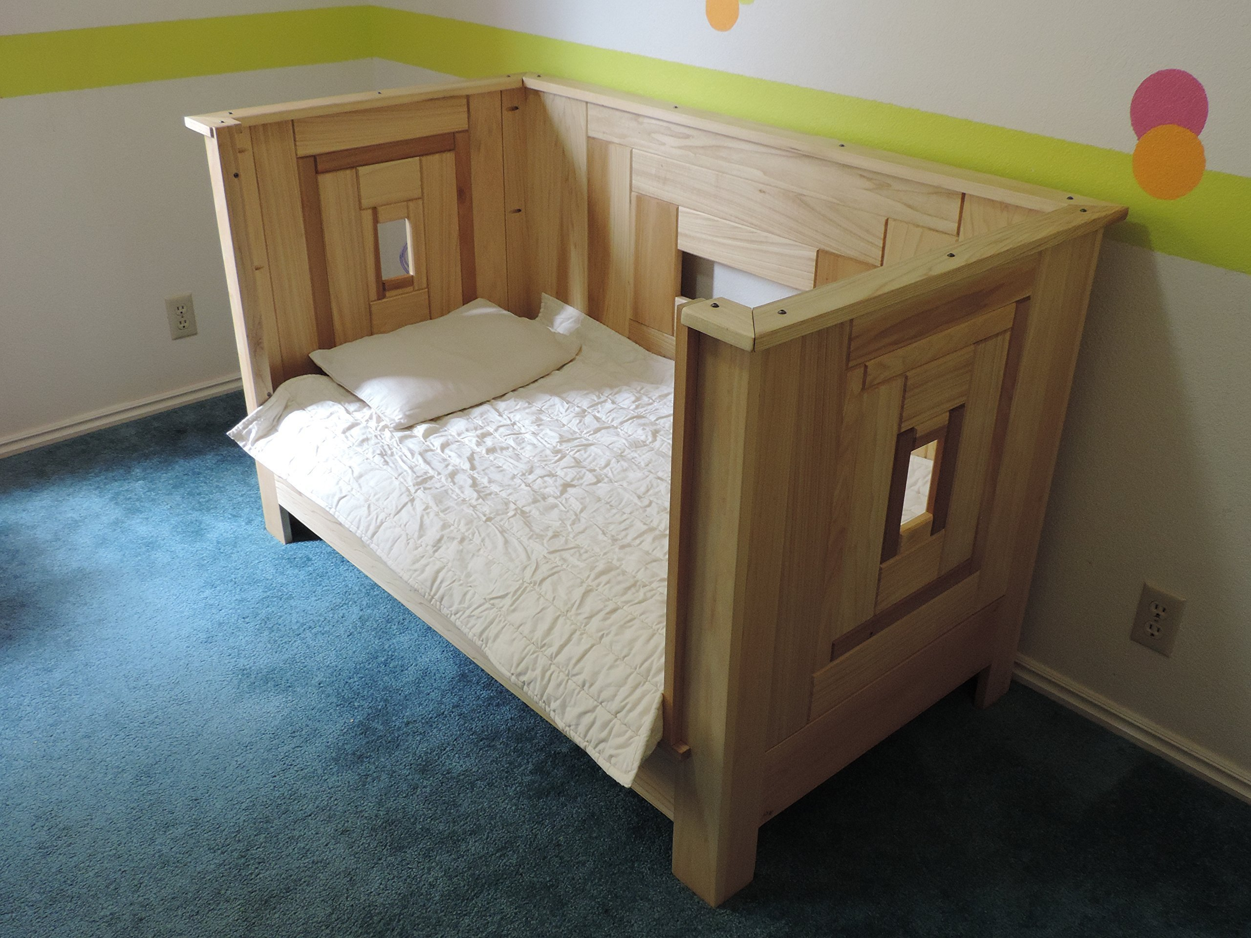 ''Fortress of babytude'' crib, convertable to toddler bed