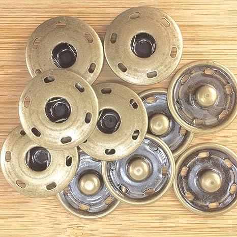 Cierres de botón a presión metálicos grandes plateados ...
