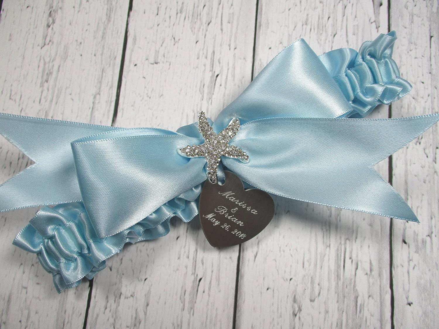 Blue Wedding Garter with a Rhinestone Heart and Personalized Engraving