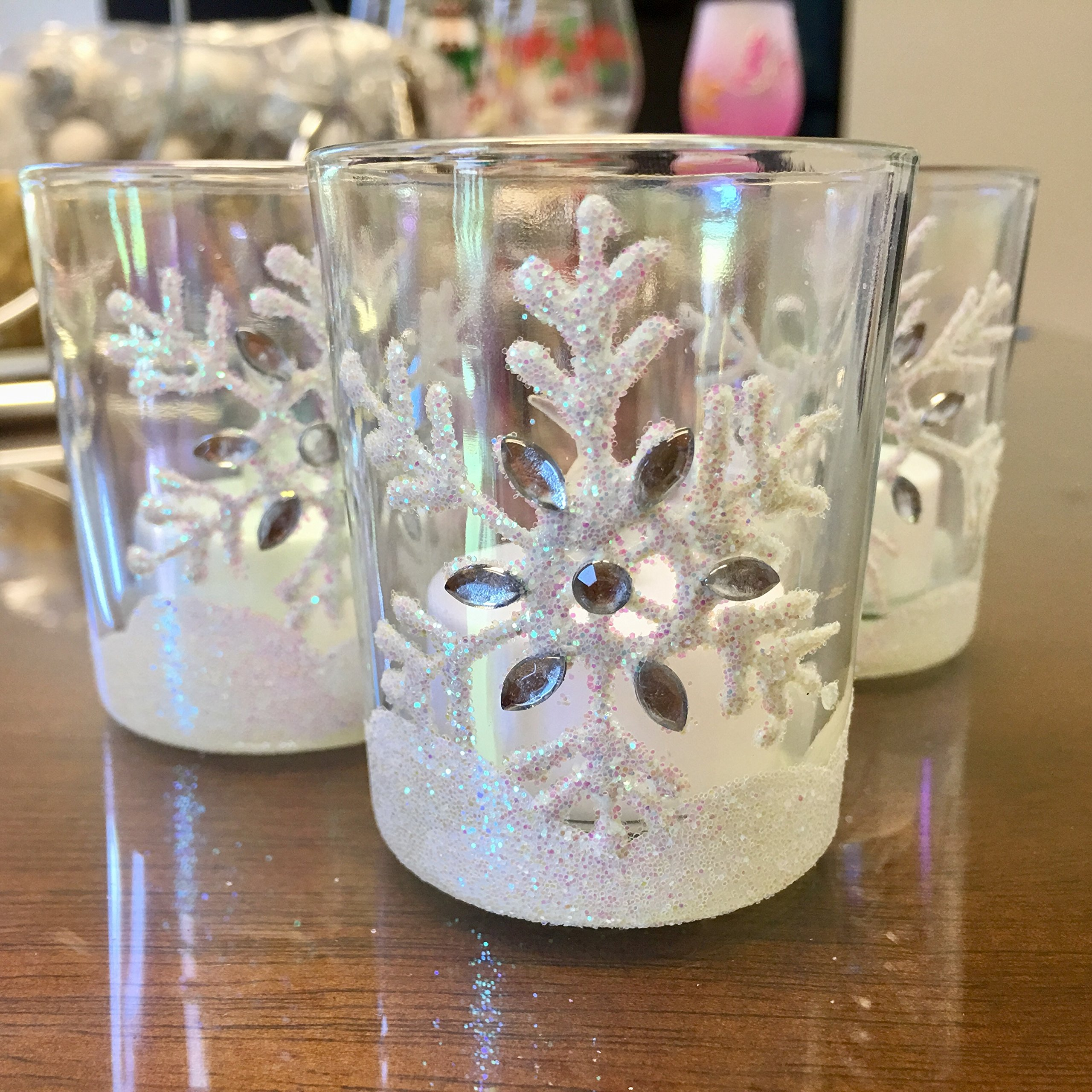 Banberry Designs Snowflake Candles – Set of 3 Glass Votive Candleholders with White Glittered Snowflakes - Flameless Flickering LED Tealights Included – Metallic Rainbow Finish – Aurora Borealis