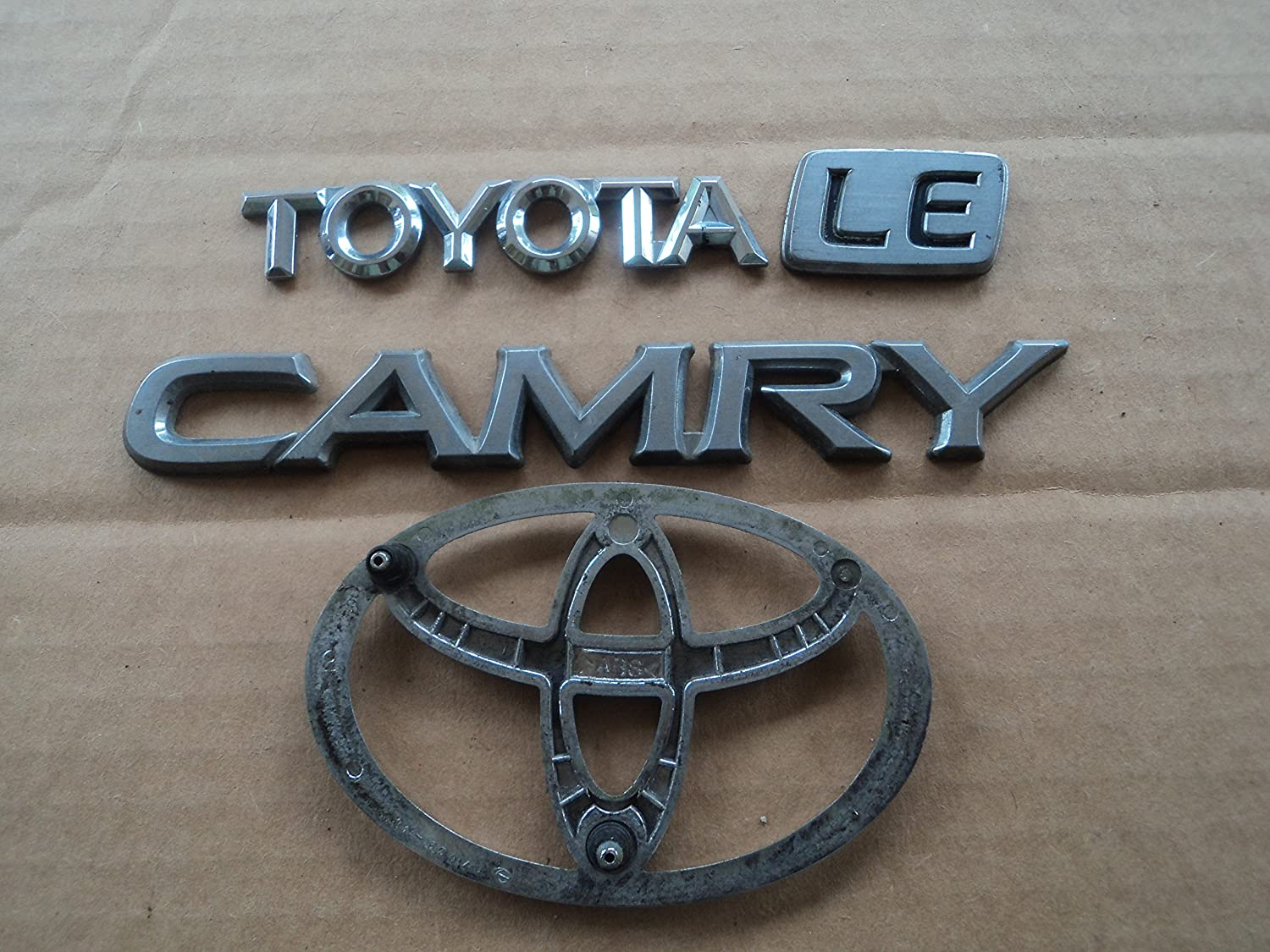 Toyota Camry LE trunk emblem badge decal logo rear chrome OEM Genuine Stock