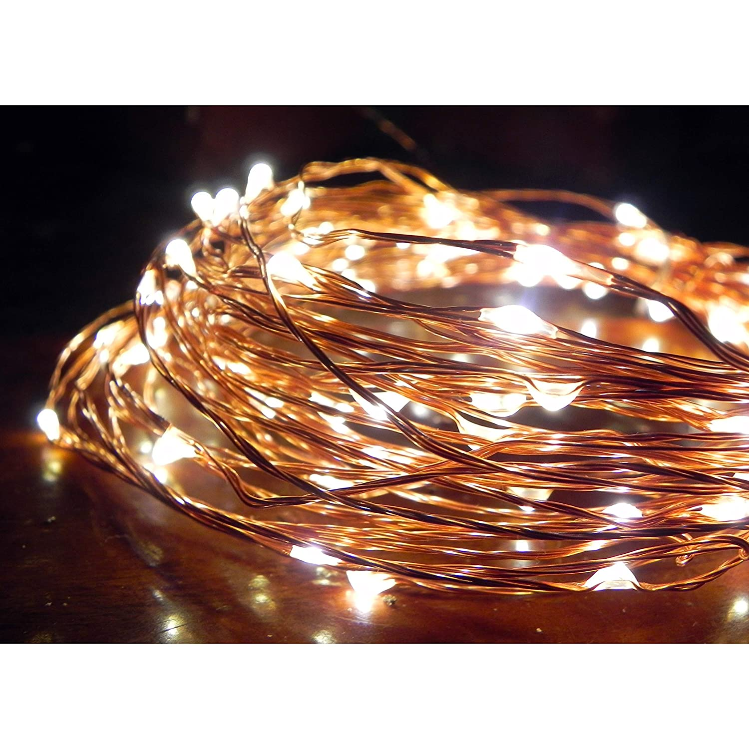 Norsis Fairy Lights - Flexible Copper Wire Starry String Lights - 100 Miniature LED Lights, Extra Long Wire - Warm White Light - Indoor/Outdoor - Interior Decor, Wedding, Craft and DIY