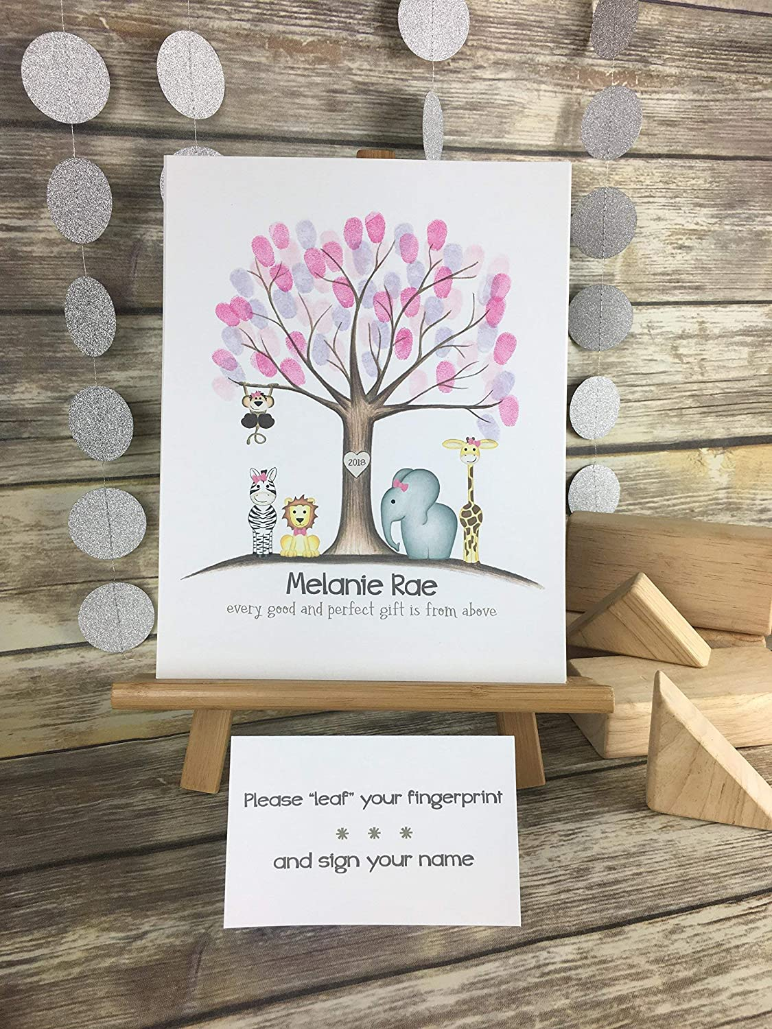 Customizable fingerprint tree for a girl's jungle safari animal themed baby shower featuring jungle animals with bows in the color of your choice.